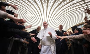 Pope Francis greets pilgrims at the Vatican.