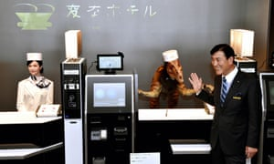 Huis Ten Bosch President Hideo Sawada with robot 'staff' at the Henn-na Hotel.