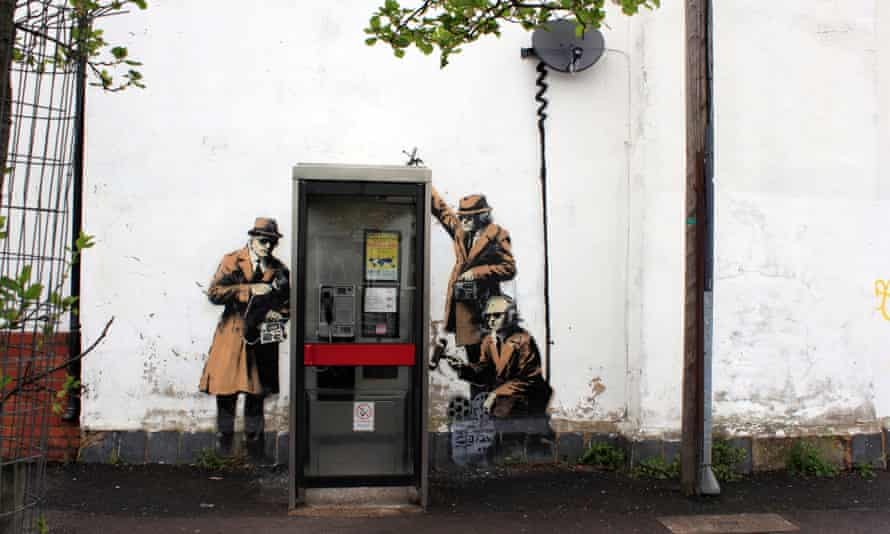 A Banksy depiction of 50s spies. Today's snoops are engaged in online deception.
