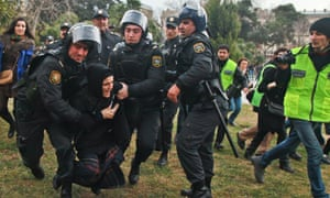 Azerbaijan police arrest demonstrators at an anti-government protest in 2013.