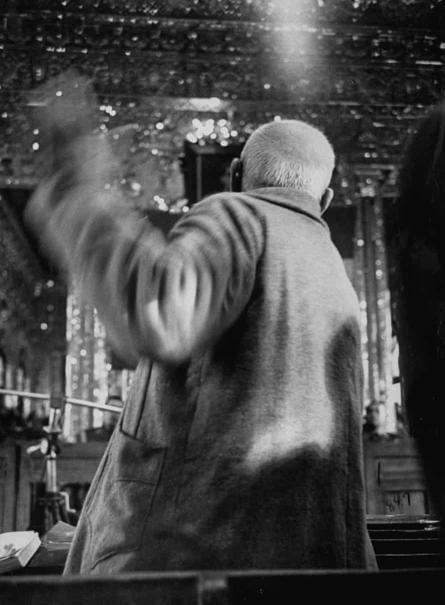 Mohamed Mossadegh, bundled in a camel's hair coat over pajamas, flailing a furious fist at court.