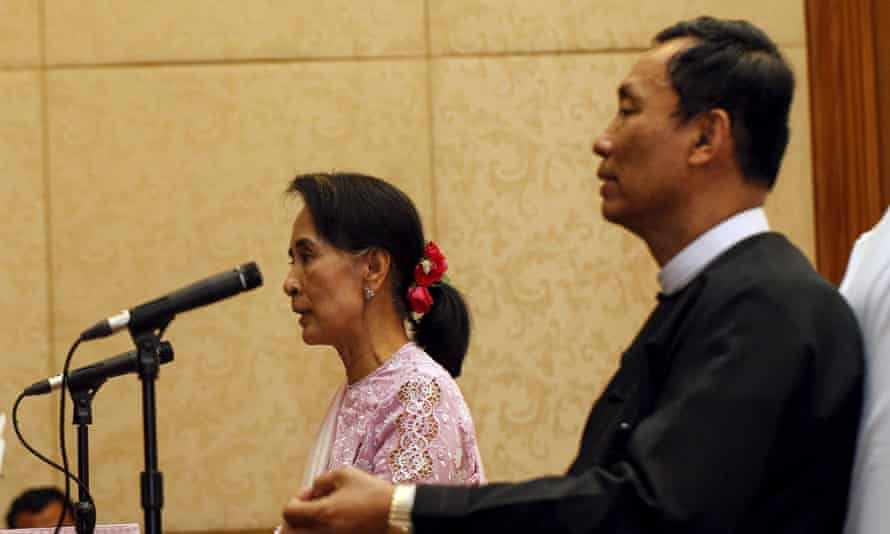 Myanmar pro-democracy leader Aung San Suu Kyi talks to the media as Shwe Man, speaker of the parliament, sits beside her at a joint news conference in March 2014.