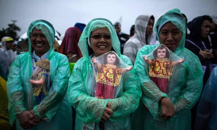 Catholics wait for Pope Francis to visit Manila.