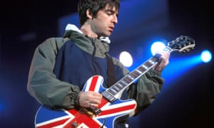 Noel Gallagher plays his union jack guitar.
