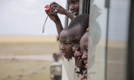 Children from Nairobi viewing wildlife from the bus on their visit to Amboseli National Park, on World Elephant Day, 12 August 2015.