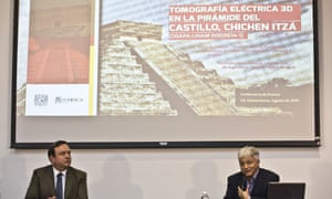 Rene Chavez (right), researcher at the Institute of Geophysics of the National Autonomous University of Mexico, speaks next to Arturo Iglesias, director of the institute, about the discovery.