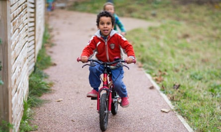 Children playing on their bikes at Lilac Grove in Leeds.