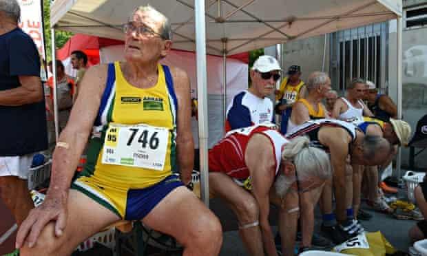 Brazil's Frederico Fischer (L) waits wit