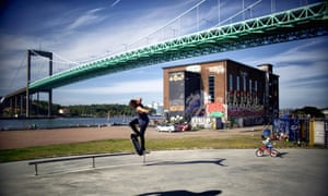 A skateboarder at Gothenburg's Älvsborg suspension bridge.