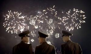 North Korean soldiers watch a fireworks display in Pyongyang.