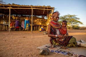 China Laprodati with her baby selling her jewellery