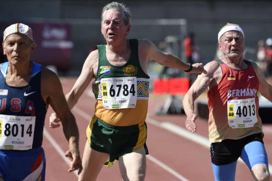 US athlete Dick Richards, left, South Africa's Ronald Cross and Germany's Karl-Heinz Neumann compete in the men's 100m final for 80-year-olds.