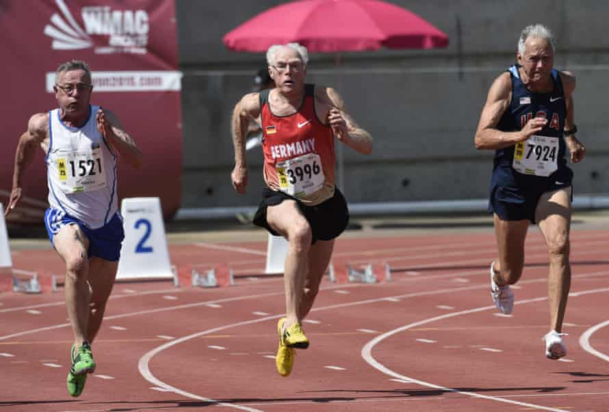 From left: Finland's Aimo Mikkola, Germany's Guido Muller (C) and the US's Robert Lida run the men's 75-years-old 100m final.