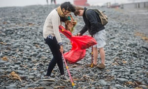 Student volunteers clean litter from the beach in Aberystwyth, Wales, last year.