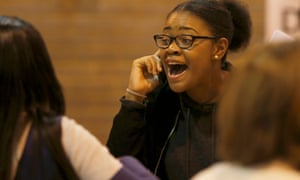 A student reacts after receiving her A-level exam results at the Harris City Academy in London.