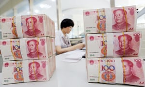 stacks of yuan: No one knows why it has been devalued