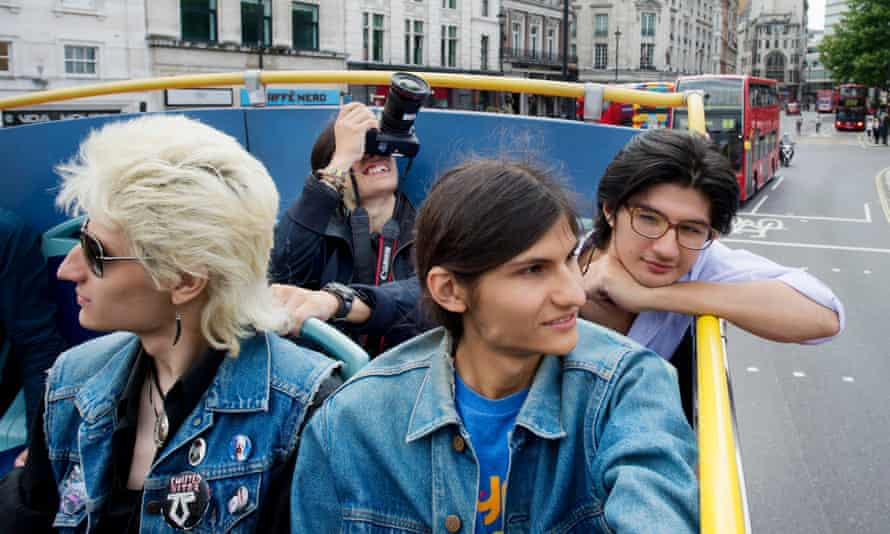 The Angulo brothers take in the London sights atop an open-air bus.