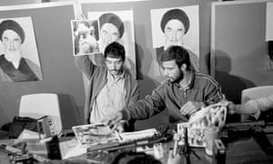 A representative of the Iranian students holds up a portrait of one of the blindfolded hostages, during a press conference in the U.S. Embassy in Tehran, Nov. 5, 1979.