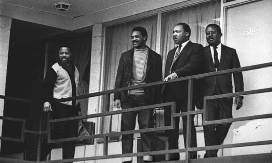 Jesse Jackson (second left) stands next to Martin Luther King on 3 April 1968, on the balcony at the Lorraine Motel where King was assassinated the following day.