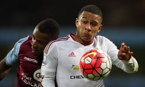 Leandro Bacuna of Aston Villa and Manchester United's Memphis Depay in action at Villa Park