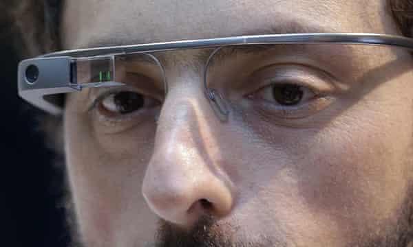 Google co-founder Sergey Brin wears a Google Glass device.