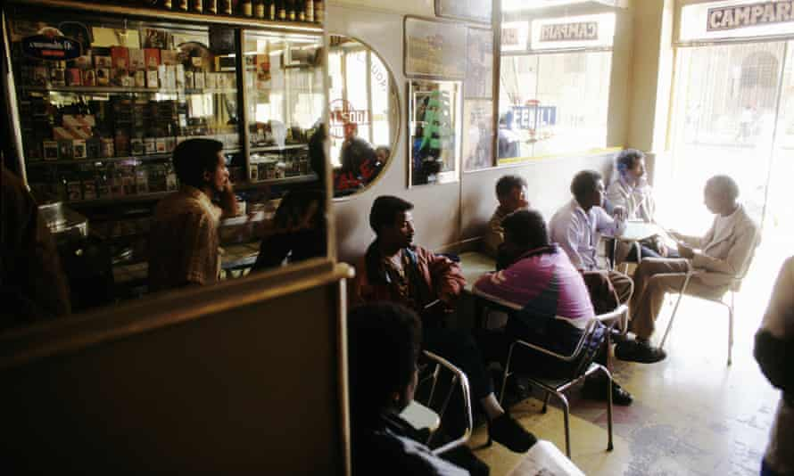 Men in a cafe in Asmara, Eritrea. Much of the city's architecture was built by Italian colonisers in the 1930s.