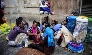 Migrants from Eritrea wait at the Milan train station in June.