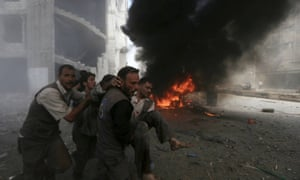 Casualties are taken away from Syrian market after bombing