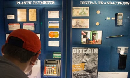 A visitor looks at a display featuring Bitcoin and the Bitcoin exchange rate since 2014, at the National Museum of American History.