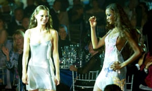Kate Moss and Naomi Campbell share the catwalk in 1999.