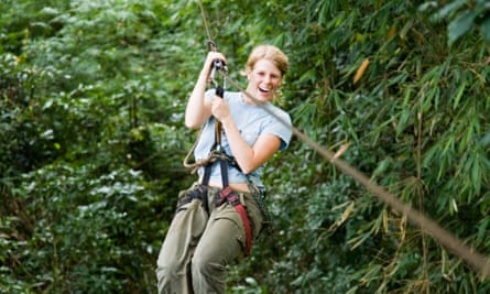woman riding a zip wire