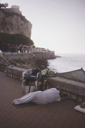 A migrant sleeps on the street in Ventimiglia
