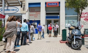 Customers queue to use a cash machine at a Eurobank branch in Athens in July
