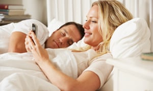 woman on phone in bed