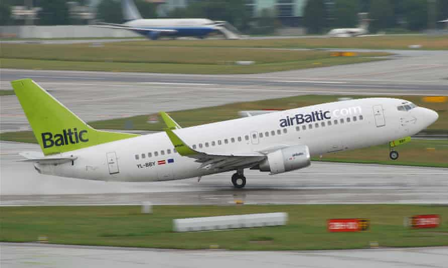 An airBaltic co-pilot was given a jail sentence after drinking heavily before a flight.