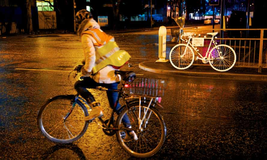 A cyclist passes a ghost bike in Manchester, commemorating cyclist Artur Piotr Ruszel, who was killed in January after colliding with a car on Upper Brook Street in the city.
