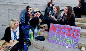 Do these fans queuing in Trafalgar Square for a chance to glimpse the stars of Harry Potter and the Deathly Hallows know that their sign is in Latin...?