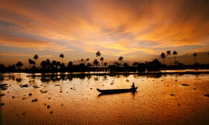A canoe at dusk in the backwaters of Kerala, India.