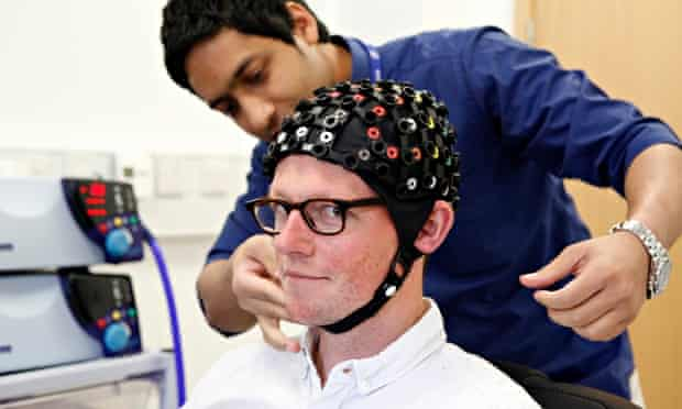 Tom Ireland tries out transcranial magnetic stimulation at the Institute of Neuroscience, Newcastle University.