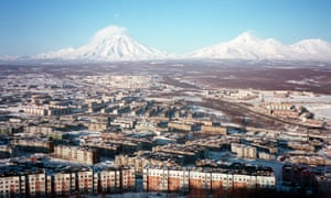 Two active volcanoes loom over the Russian city of Petropavlovsk-Kamchatsky.