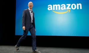 Amazon CEO Jeff Bezos walks on stage for the launch of the Amazon Fire Phone