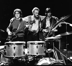 Ginger Baker (centre) with Jack Bruce and Eric Clapton in Cream.