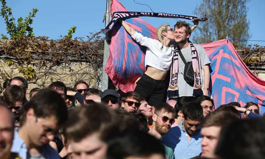 Dulwich Hamlet FC fans with banners at match