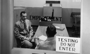 A job applicant is interviewed at the Cities Service Oil Company refinery at Lake Charles, Louisiana, circa 1955