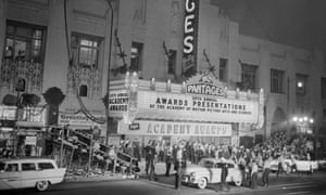 Crowds and the press await the first arrivals for the 28th Academy Award presentations, Hollywood, Los Angeles, March 1956.