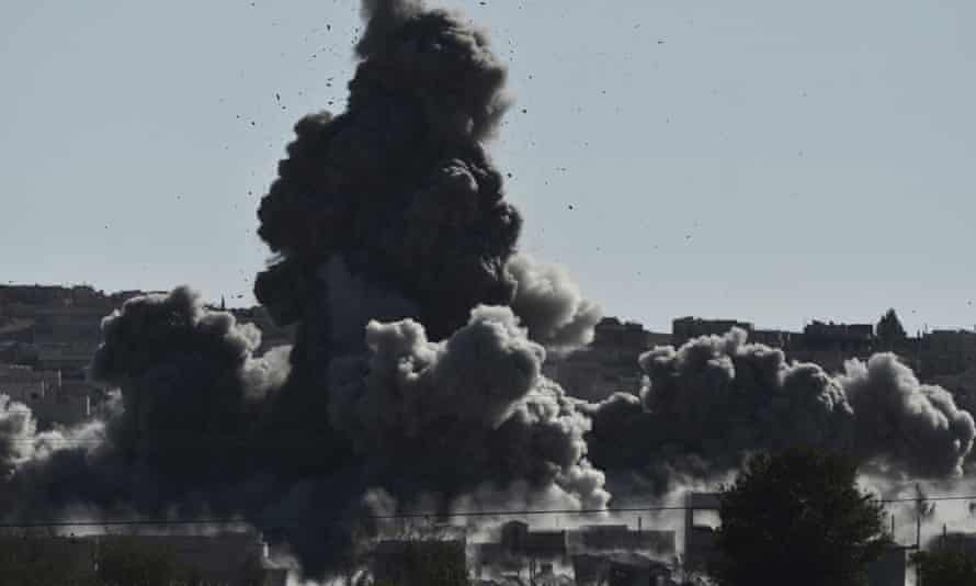 Smoke rises after an airstrike on the city of Kobane in Syria