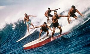 five men surfing