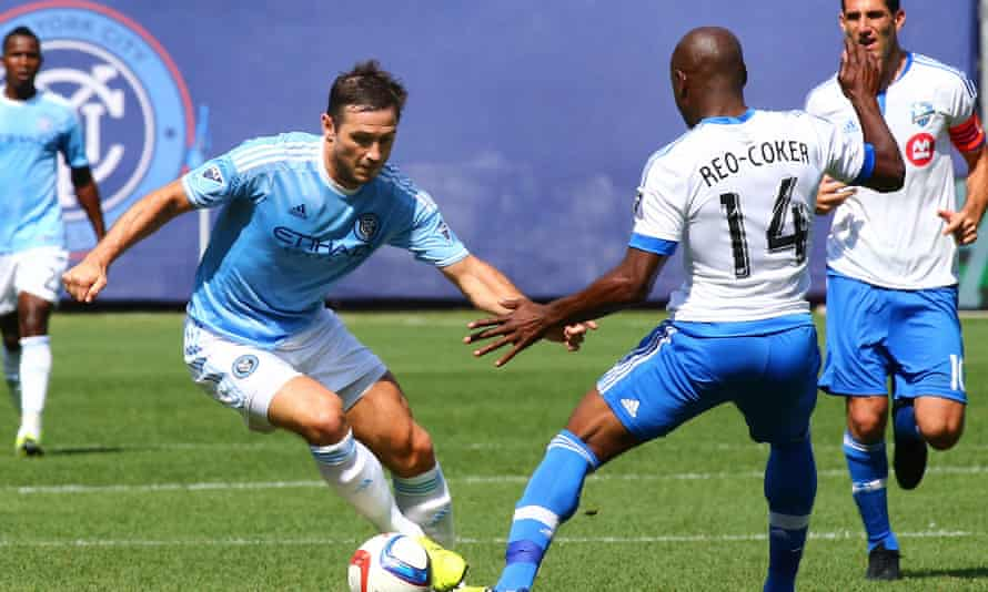 Frank Lampard takes on Nigel Reo-Coker during his New York City debut at Yankee Stadium.