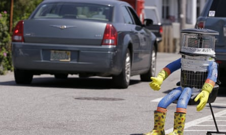 A car drives by Hitchbot  in Marblehead, Massachusetts, in July.