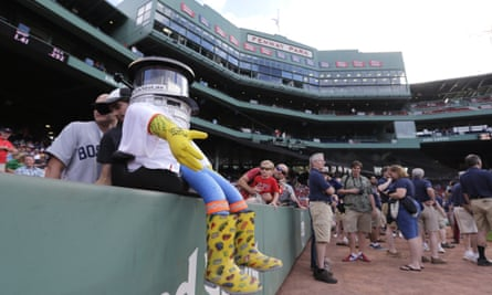 Hitchbot rests on a wall before a baseball game at Fenway Park between the Boston Red Sox and Detroit Tigers in Boston on 24 July.